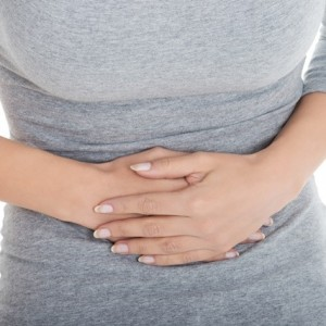 Young casual girl woman is having stomach ache.